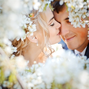 bigstock-kissing-wedding-couple-in-spri-12138419.jpg