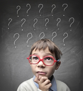 bigstock-Child-with-many-question-marks-40193056