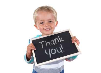 bigstock-Young-child-holding-thank-you--37152475