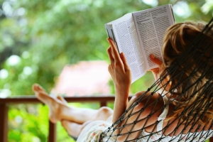 bigstock-Young-woman-reading-a-book-lyi-14022518
